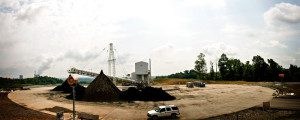 tower mounted dust control machines aimed at fly ash stockpile
