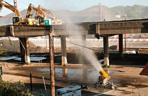 Doyle Drive demolition using misting cannon to control dust on Golden Gate bridge route near Presidio