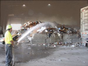Fire hose dust suppression