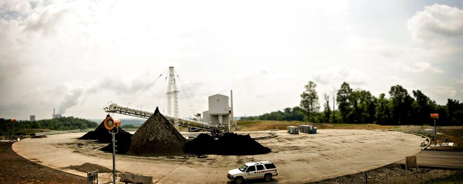 Fly ash stockpile with dust suppression