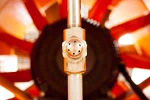 Odor control atomizing nozzle