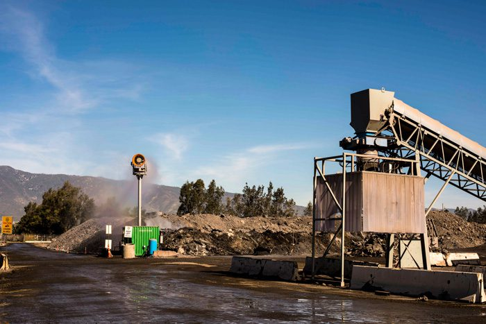Controlling and cooling slag dust with tower mounted dust suppression system