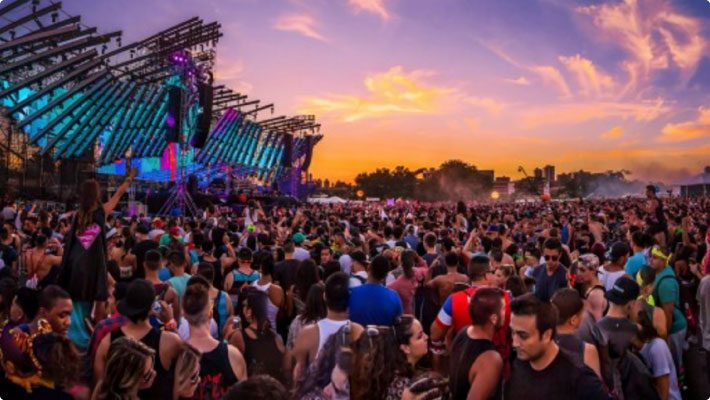 Electric zoo festival at sunset with crowd