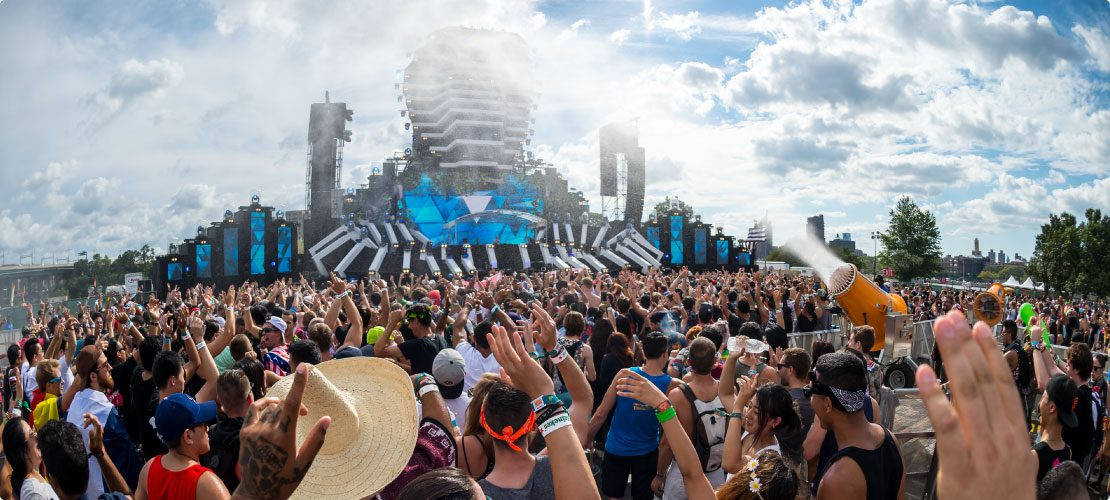 Electronic music festival fires up mist cannons for crowd cooling