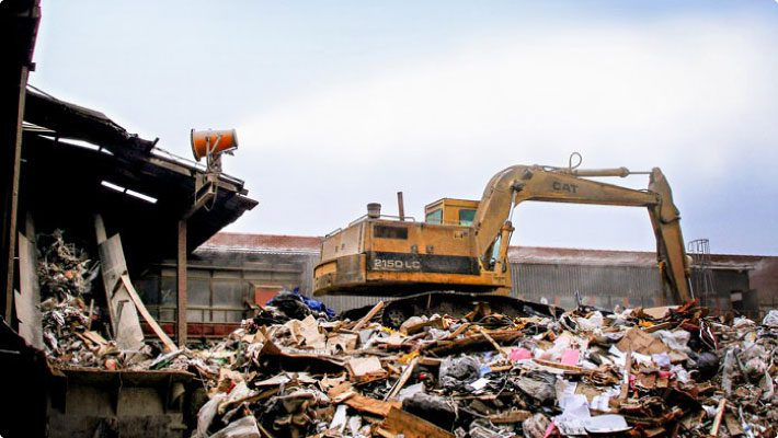 CD debris at transfer station with dust control system throwing mist