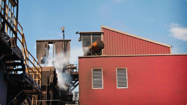Dust control system mounted above steel mill operations