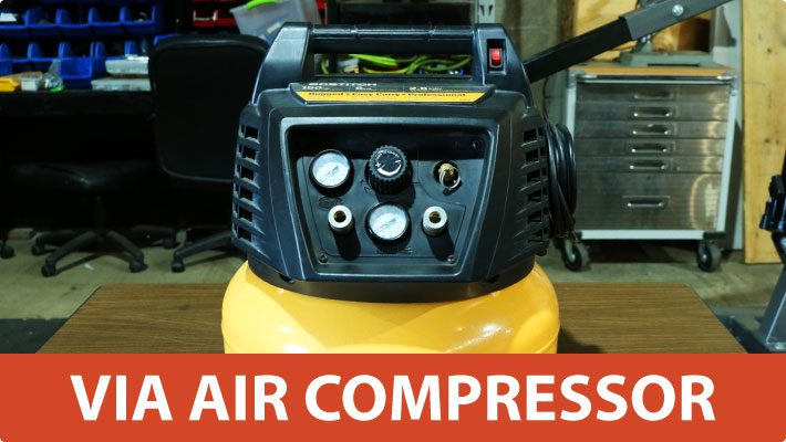 Air compressor to provide atomized misting nozzle maintenance