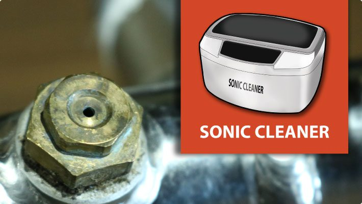 Sonic cleaner for atomized misting nozzle maintenance