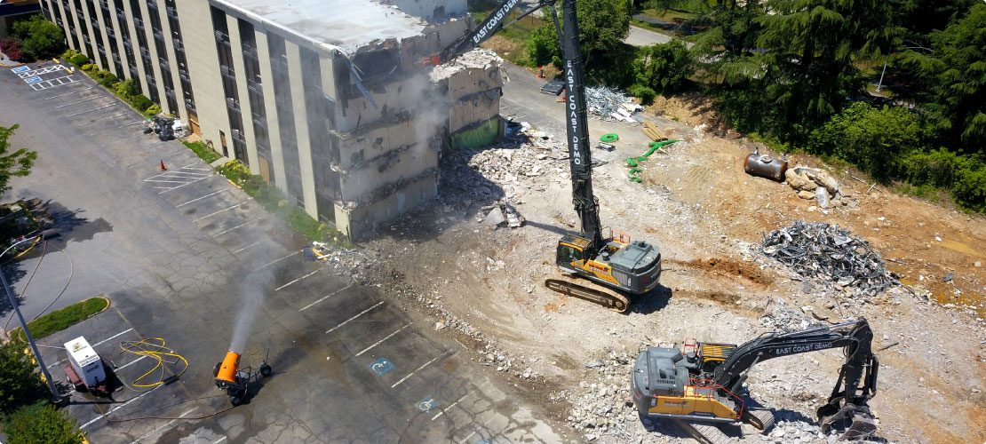 DustBoss db-60 at industrial and construction site with high-rise excavators