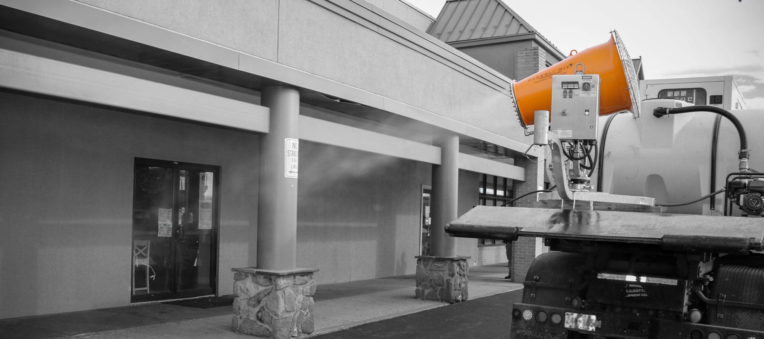 DB-30 Mounted on Water Truck Disinfecting Shopping Center Wide OPT B&W